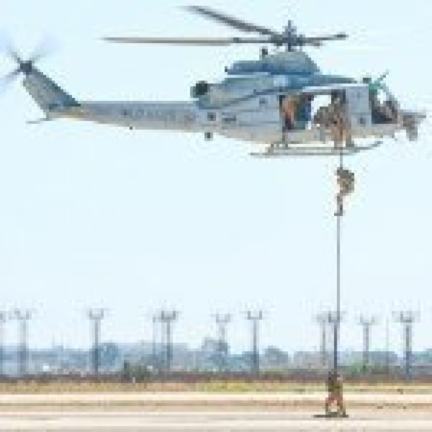 Marines rappel from the sky