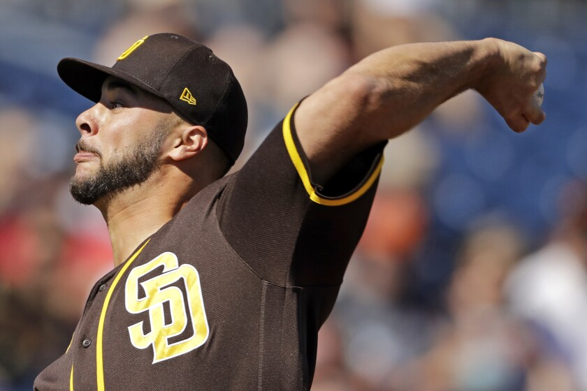 Padres pitcher Joey Lucchesi throws during a spring training game in March.