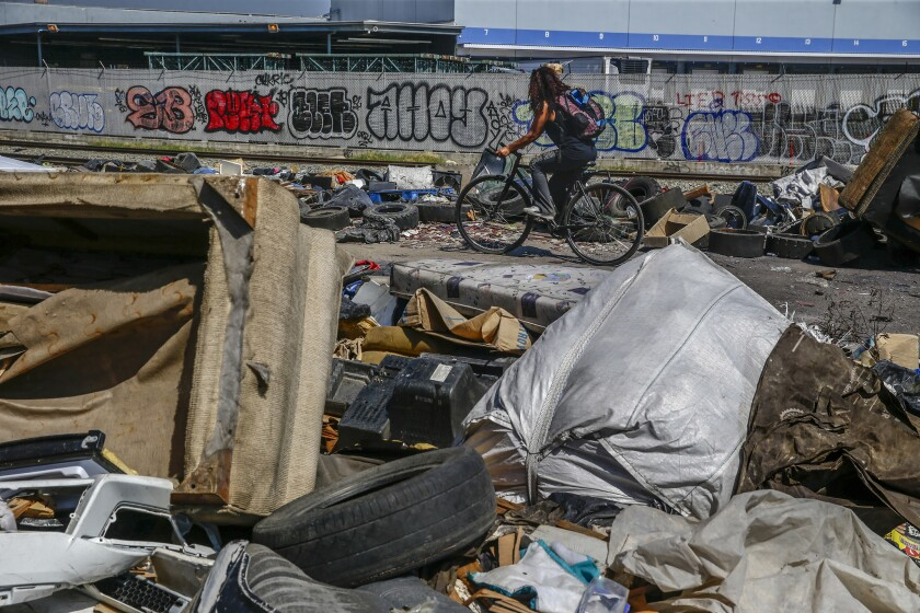 LOS ANGELES, CA, THURSDAY, MAY 30, 2019 - Piles of trash remain near the intersection of 25th St. an