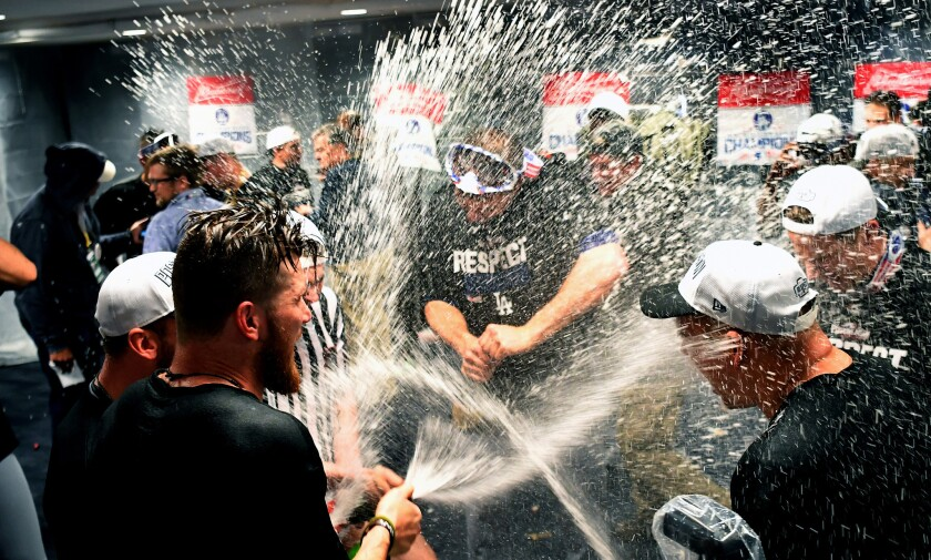 Players celebrate in the Dodgers locker room after their 2016 defeat of the Nationals