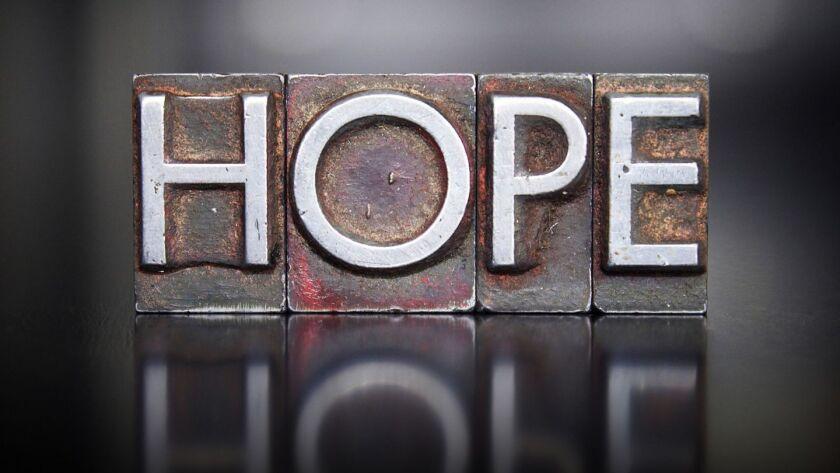 The word HOPE written in vintage letterpress lead type