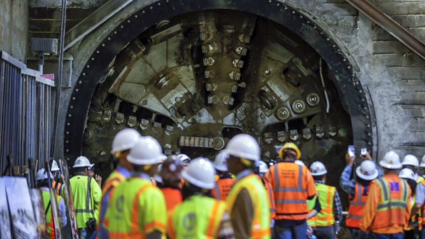 A tunnel-boring machine breaks through at the site of Leimert Park Station.