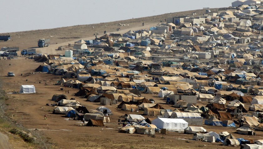 Climate change probably worsened the drought that preceded Syria's uprising, a new study suggests. Here, a refugee camp is seen in Syria near the Turkish border town of Cilvegozu.
