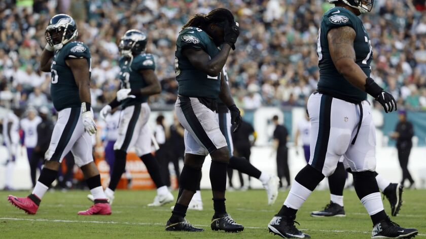Eagles running back Jay Ajayi walks off the field after fumbling against the Vikings.