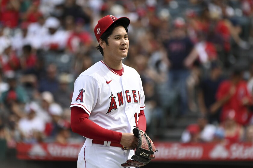 Los Angeles Angels pitcher Shohei Ohtani smiles after finishing the seventh inning of a baseball game against the Seattle Mariners, Sunday, Sept. 26, 2021, in Anaheim, Calif. The Mariners won 5-1. (AP Photo/Michael Owen Baker)