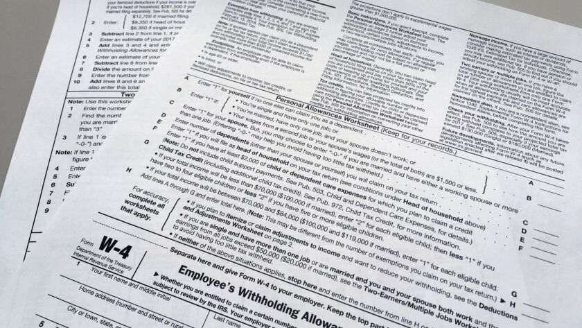 FILE - This Feb. 1, 2018 file photo shows an IRS W-4 form in New York. On Friday, May 31, 2019, the