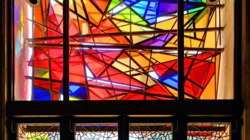 Although abstract, the triangular shapes in Claire Falkenstein's three-dimensional stained-glass windows are meant to symbolize the Catholic doctrine of the Trinity.