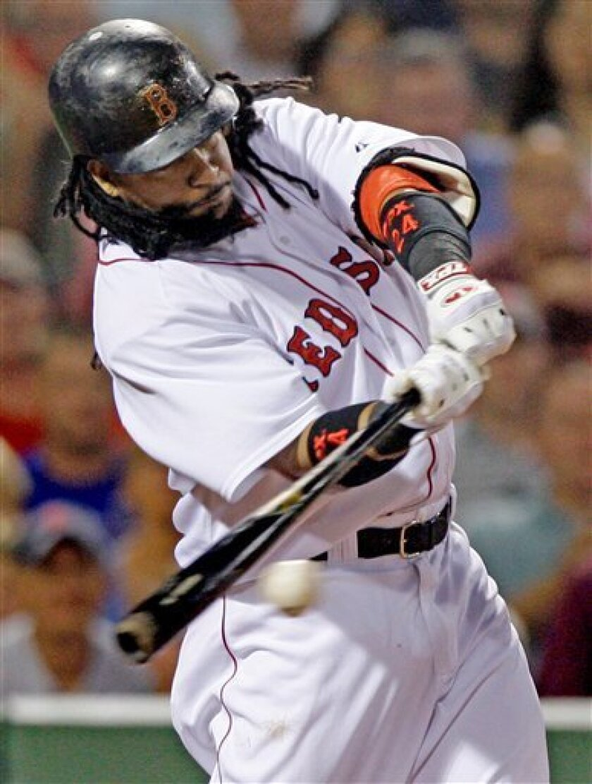 Boston Red Sox's Manny Ramirez connects on a RBI single, driving in Dustin Pedroia for the first run of the game, against the Minnesota Twins in the eighth inning of their MLB baseball game at Fenway Park in Boston, Monday July 7, 2008. (AP Photo/Charles Krupa)