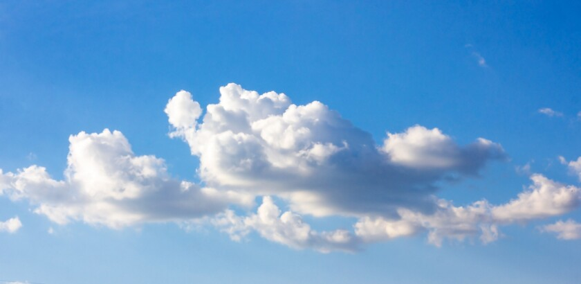Simple beautiful gloomy blue sky with fluffy clouds in summer morning peace day as a background.