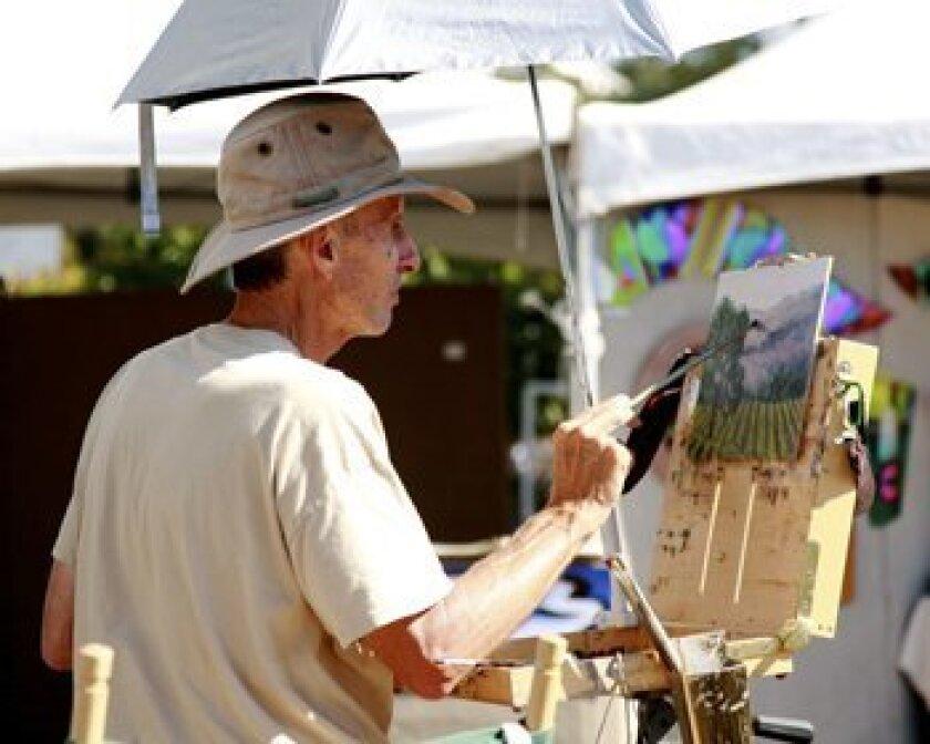 Steve Kell paints a landscape.