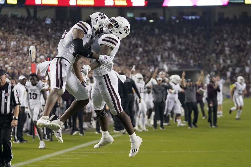 Mississippi State wide receiver Makai Polk (10) and running back Jo'quavious Marks (7) react after Polk scored a touchdown against Texas A&M during the first half of an NCAA college football game, Saturday, Oct. 2, 2021, in College Station, Texas. (AP Photo/Sam Craft)