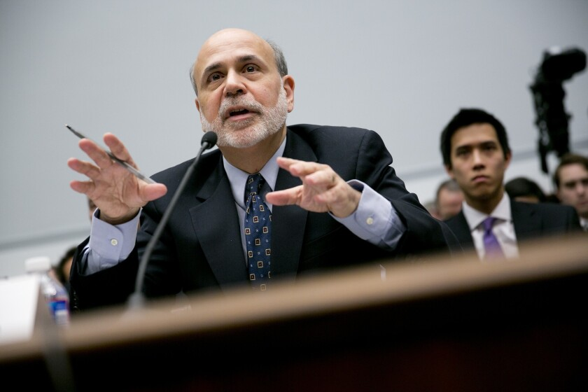 The Labor Department reported Tuesday that inflation remained low in August, data that the Federal Reserve will take into account this week in considering whether to start pulling back its bond purchases. Above, Fed Chairman Ben S. Bernanke testifies before Congress in February.