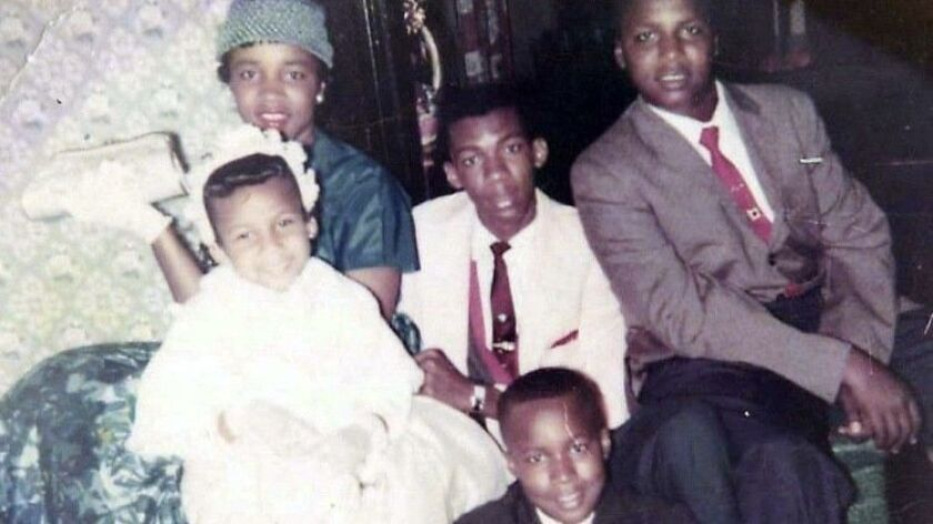 Big Willie Robinson (center, white suit) with his four siblings (from left), Jean, Gwendolyn, Kennet