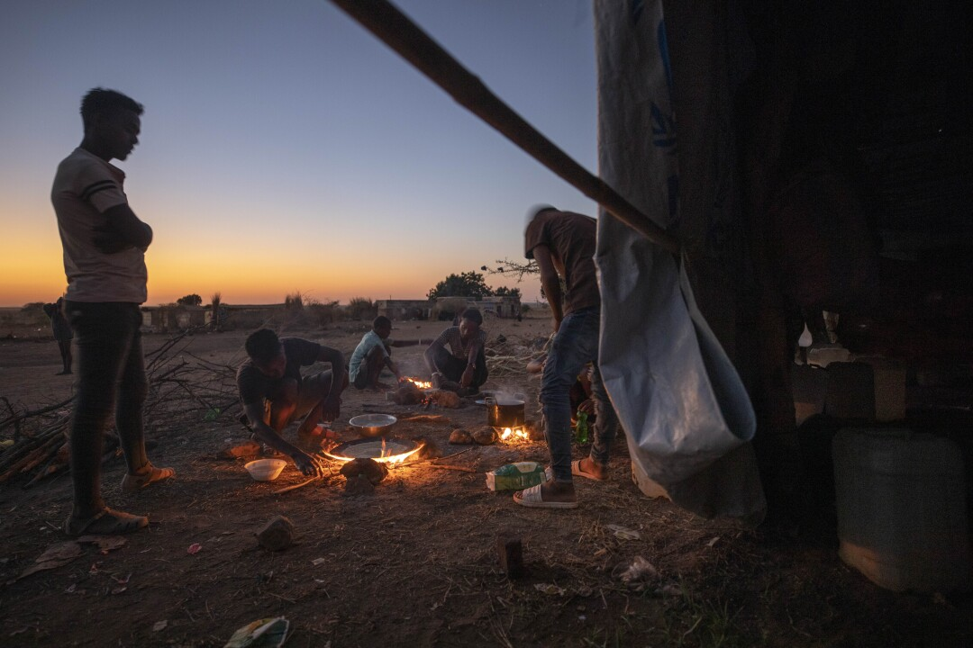 Tigray refugees light fires to prepare dinner at Umm Rakouba refugee camp Sudan