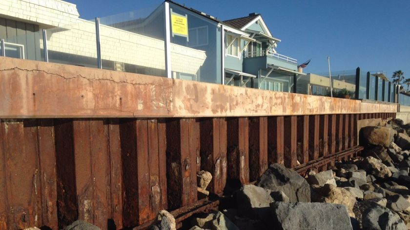 A new FEMA flood map says seawalls such as this one in Del Mar may be insufficient.