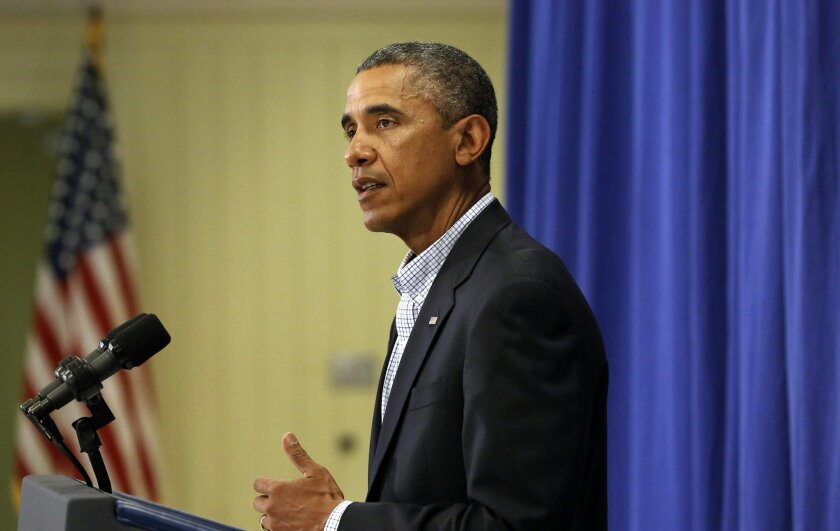 President Barack Obama speaks to reporters, Thursday, Aug. 14, 2014, in Edgartown, Mass. about developments in Iraq and the police shooting of 18-year-old Michael Brown, in Ferguson, Mo. Obama is vacationing on the island for about two weeks. (AP Photo/Steven Senne)