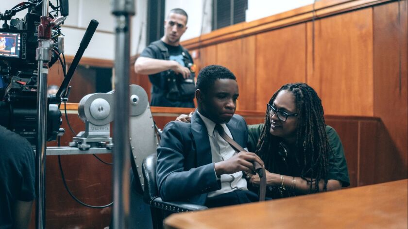 """Ava DuVernay, pictured with actor Caleel Harris on the set of """"When They See Us,"""" her four-part series about the wrongful conviction and later exoneration of the group of teenagers known as the Central Park Five."""