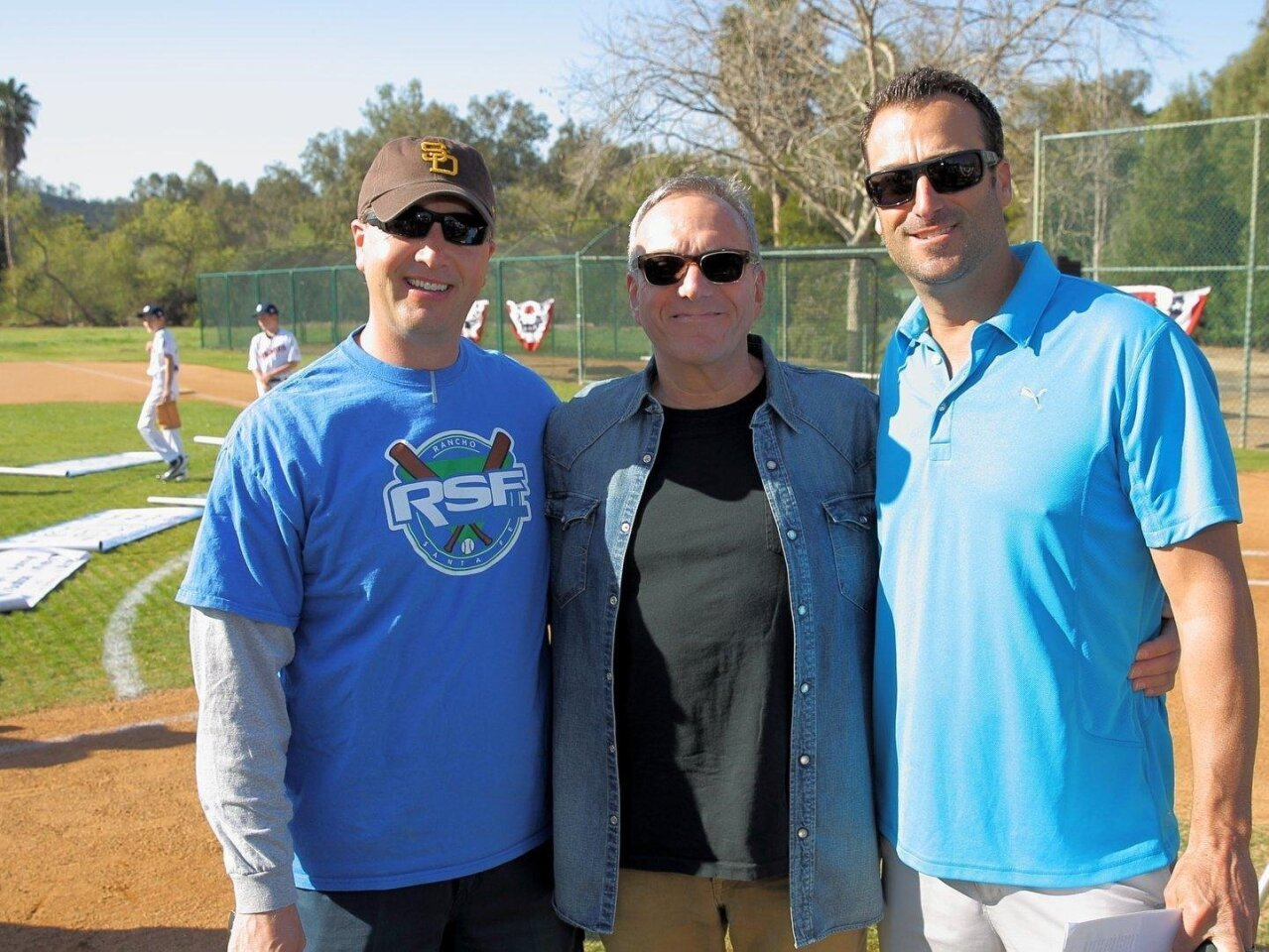 RSFLL past-president Tyler Seltzer, long-time supporter Mitch Levy, and current president Jeff Daley