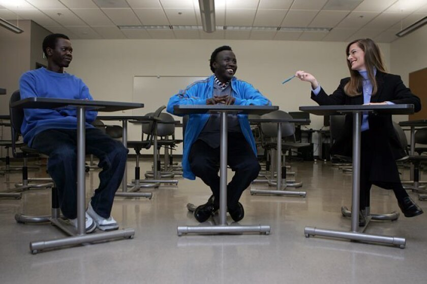 Santino Aluat (left), 28, James Ariath, 31, and English instructor Marvelyn Bucky laughed about past fundraising mishaps during an agenda meeting for the Sudanese Cultural Club, which is made up of more than a dozen fellow countrymen who attend Cuyamaca College.
