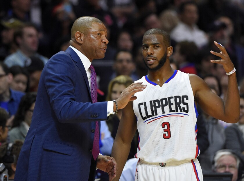 Clippers Coach Doc Rivers, left, talks with guard Chris Paul during a game against Memphis on Nov. 9.