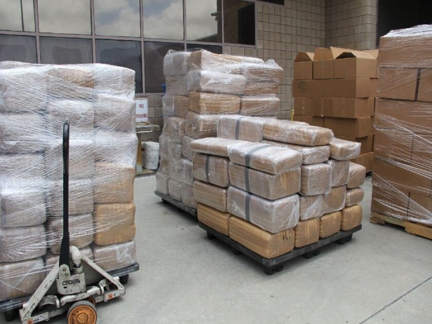 Customs and Border Protection officers seized seven tons of marijuana from a commercial truck at the Otay Mesa cargo facility Thursday, authorities said.