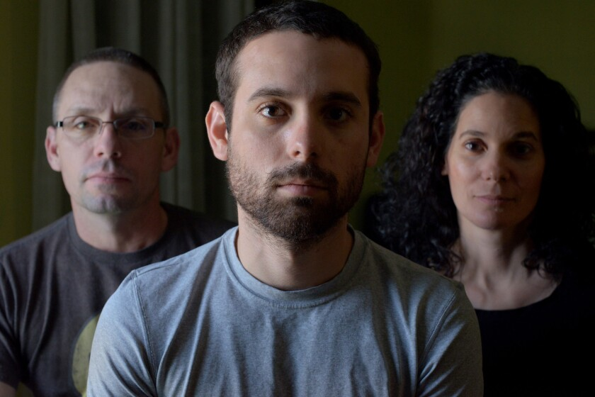 """Adam Winfield, center, with his parents, Chris and Emma in the movie """"The Kill Team."""""""