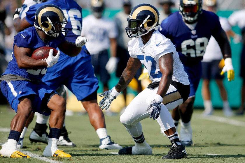 The Rams' Alec Ogletree, in white jersey, takes part in training camp at UC Irvine. Ogletree is switching to middle linebacker.