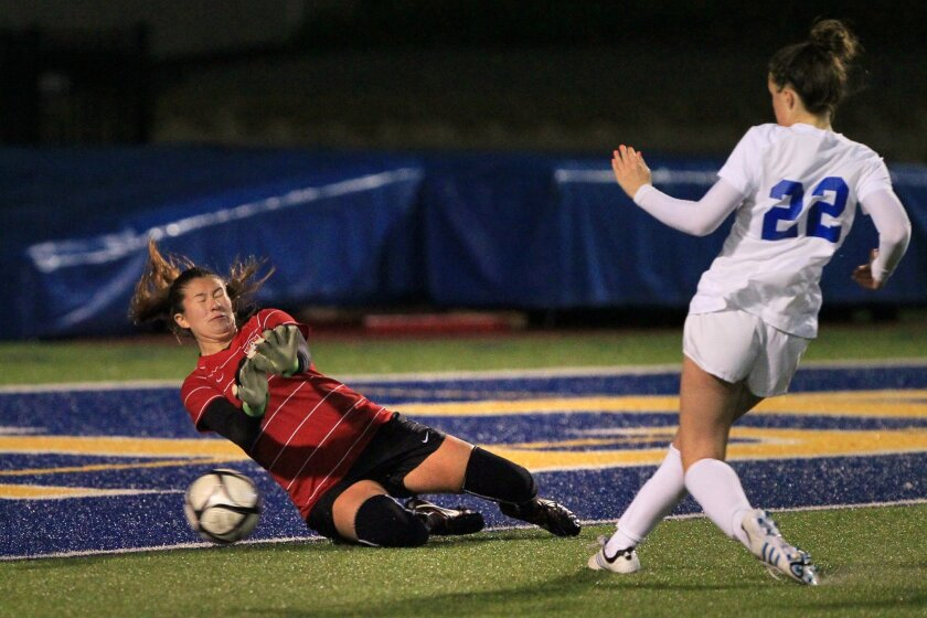San Pasqual's Samantha Haynie kicks the ball past Vista goalkeeper Priscilla Suarez in overtime to score the winning goal.
