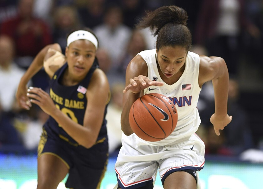 Connecticut's Megan Walker takes off with a steal from Notre Dame's Katlyn Gilbert, left, in the first half of an NCAA college basketball game, Sunday, Dec. 8, 2019, in Storrs, Conn. (AP Photo/Jessica Hill)