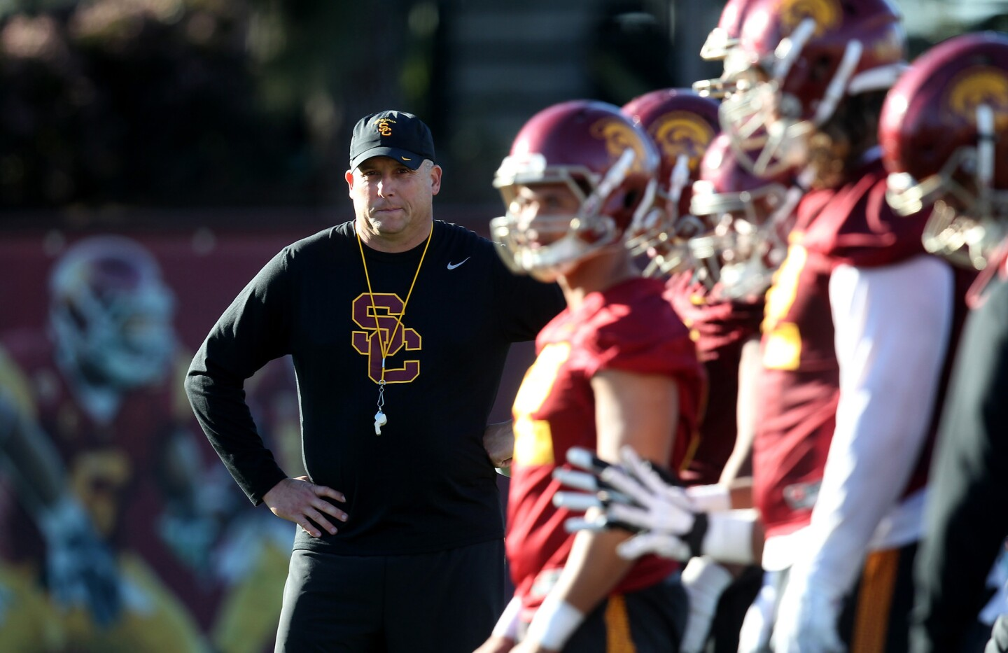Head Coach Clay Helton watches his Trojan squad on the first day of spring practice at USC's Howard Jones Field.