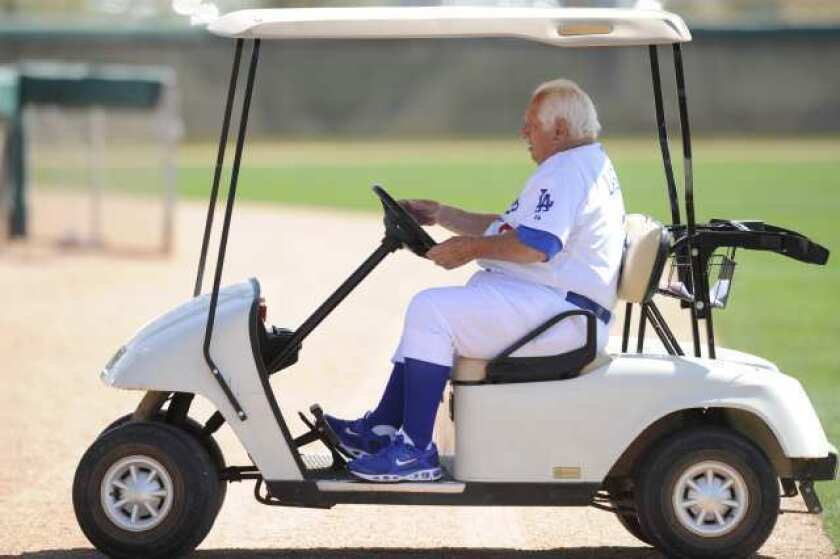 Tommy Lasorda drives a golf cart around the Dodgers' spring training facility at Camelback Ranch.