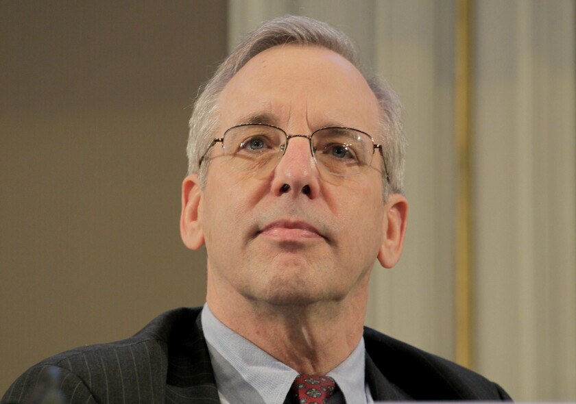 William Dudley, president of the Federal Reserve Bank of New York, listens during the International Symposium of the Bank of France policy conference in Paris in 2014.