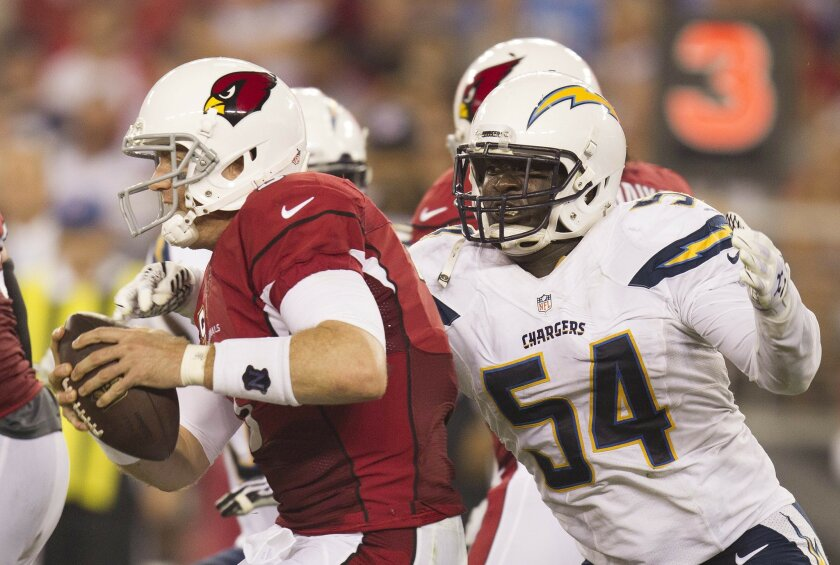 The San Diego Chargers vs The Arizona Cardinals at University of Phoenix Stadium.   Melvin Ingram with pressure on Carson Palmer in the first quarter.