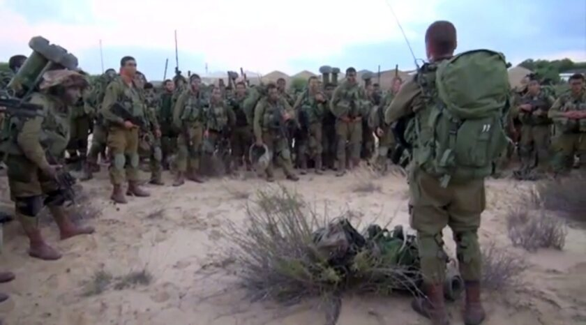 Israeli infantry soldiers receive a briefing in the Gaza Strip on July 18.