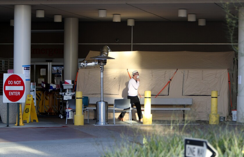 A large tent has been set up outside of Adventist Health Glendale's emergency room to act as an off-site intake location for a possible influx of new patients suspected of having the coronavirus.