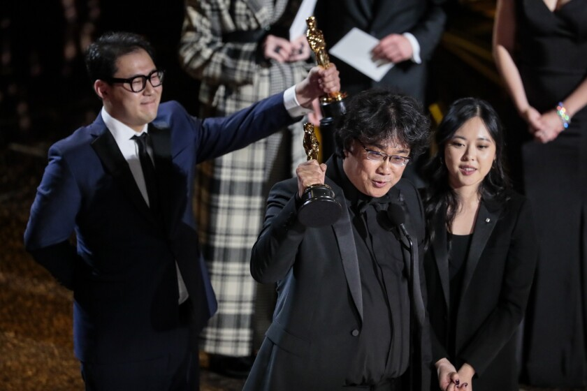 """Bong Joon Ho and Han Jin Won, winners of the original screenplay Oscar for """"Parasite""""during the telecast of the 92nd Academy Awards."""