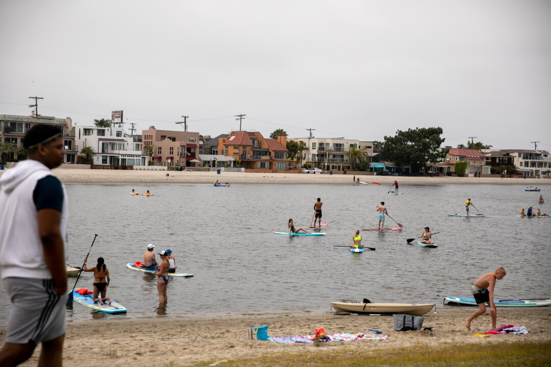 Paddleboards launch into Mission Bay from near the Mission Bay Sportcenter on Memorial Day.