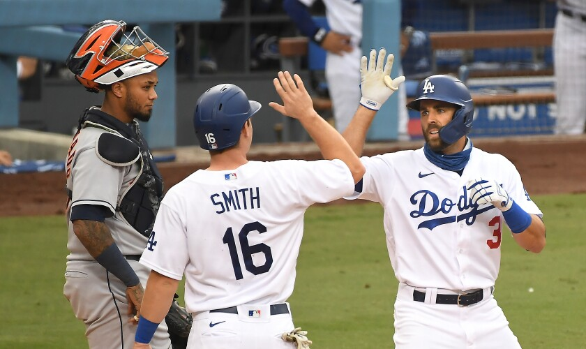 Chris Taylor celebrates a two-run home run with Will Smith.