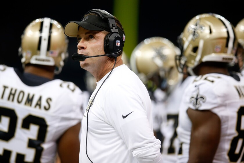 New Orleans Coach Sean Payton stands on the sideline during a game against Arizona in 2013.