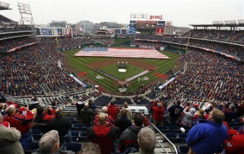 A giant American flag fills the outfield for the national anthem before the Washington Nationals opening day baseball game against the Atlanta Braves, Thursday, March 31, 2011, in Washington.(AP Photo/Alex Brandon)