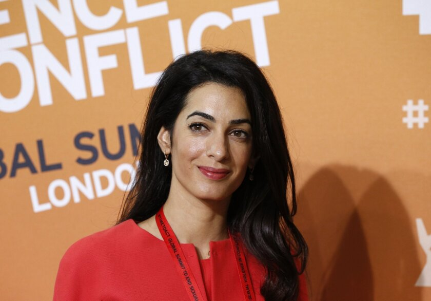 FILE - The June 12, 2014 file photo shows Amal Alamuddin, human rights lawyer and fiancee of US actor George Clooney, as she attends the 'End Sexual Violence in Conflict' summit in London. Alamuddin has been chosen for the U.N.'s three-member commission of inquiry looking into possible violations of the rules of war in Gaza, United Nations Human Rights Council said Monday, Aug. 11, 2014. (AP Photo/Lefteris Pitarakis, file)