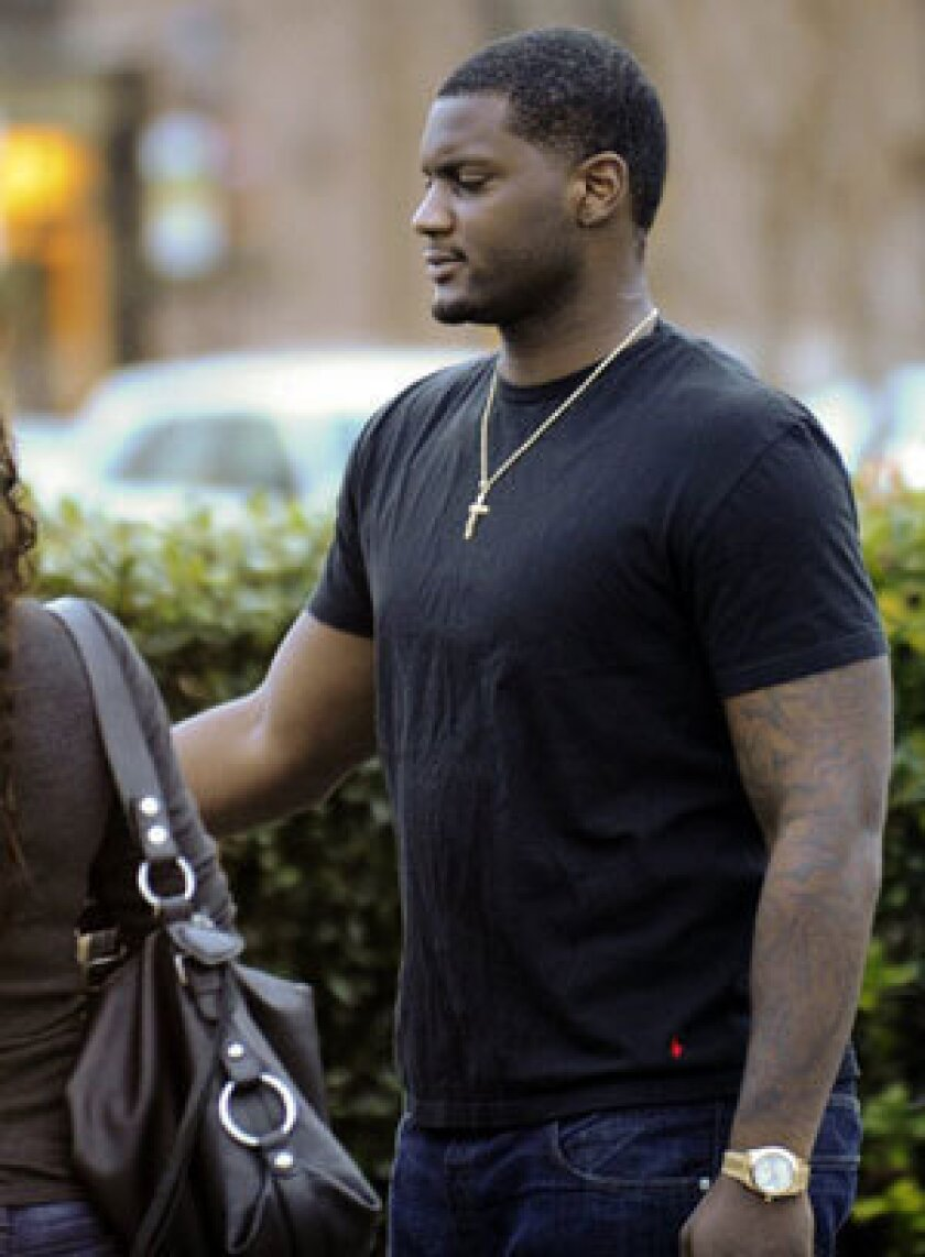 Rolando McClain leaves the Decatur, Ala., police station after posting bail Tuesday.