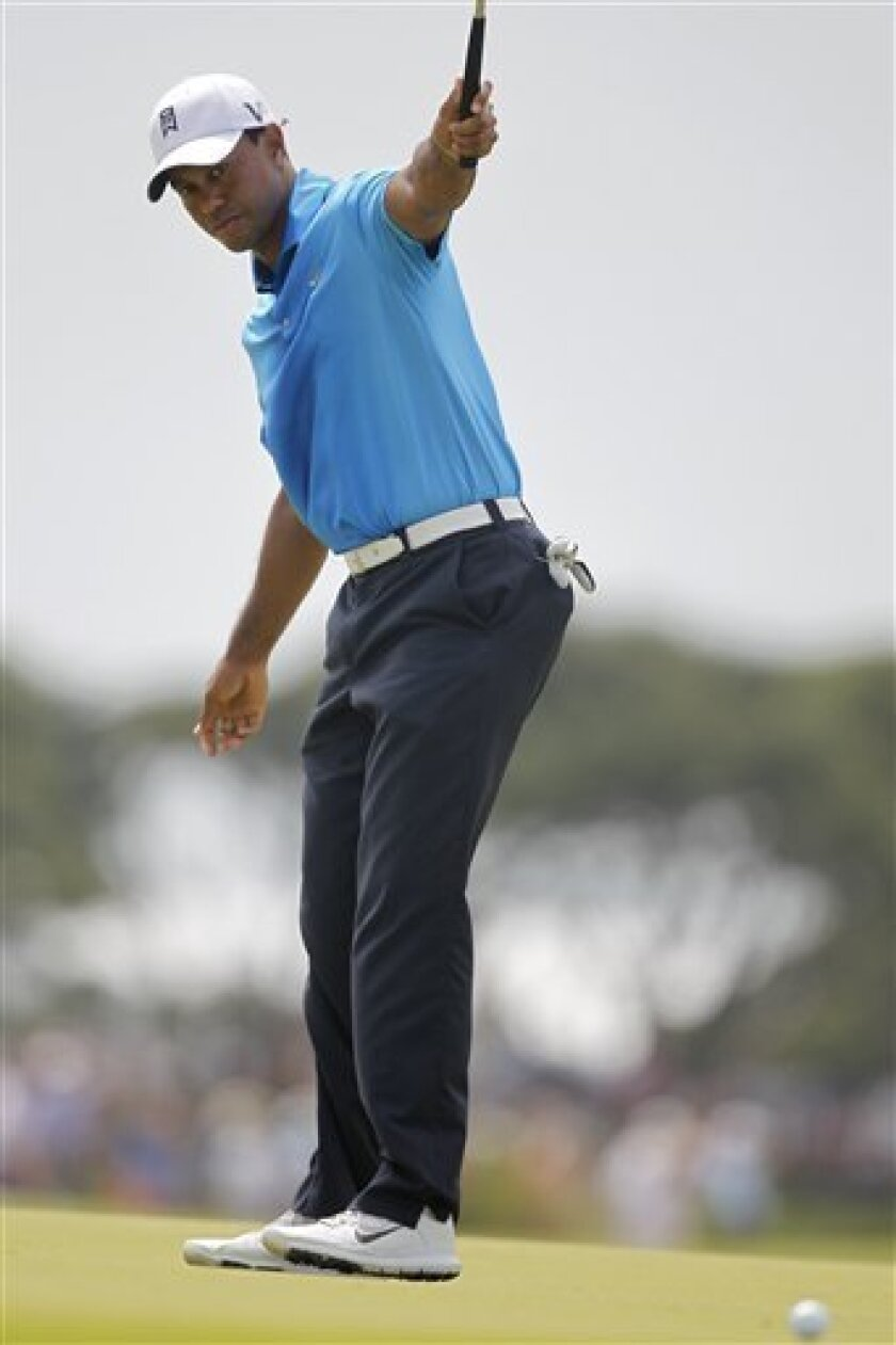 Tiger Woods reacts to his birdie putt on the third hole during the second round of the PGA Championship golf tournament on the Ocean Course of the Kiawah Island Golf Resort in Kiawah Island, S.C., Friday, Aug. 10, 2012. (AP Photo/Lynne Sladky)