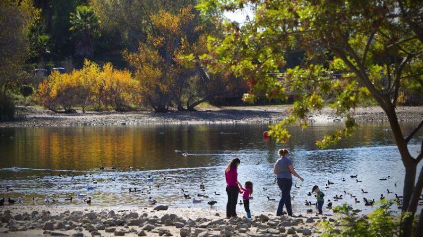 A family enjoys a walk at Lake Murray.