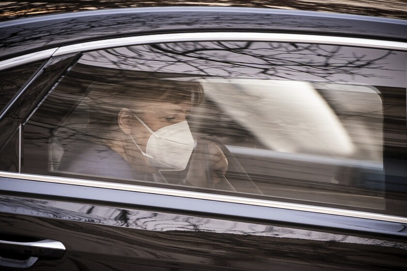 German Chancellor Angela Merkel (CDU), arrives in a car at the parliament for the beginning of the budget week in Berlin, Germany, Tuesday, Dec. 8, 2020. (Michael Kappeler/dpa via AP)