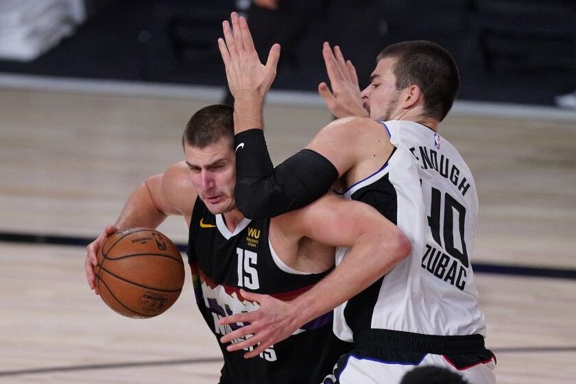 Nuggets center Nikola Jokic tries to power his way past Cippers center Ivica Zubac during Game 3 on Sept. 7, 2020.