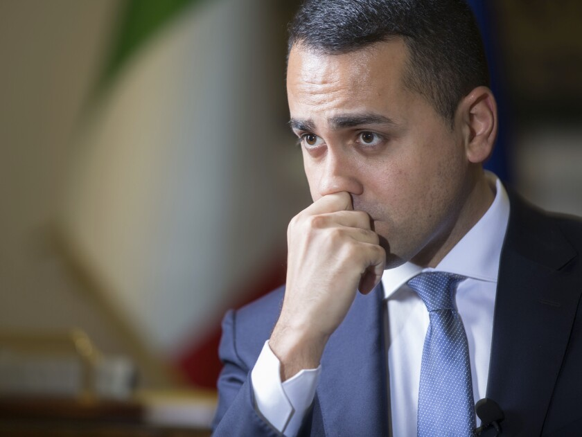 Italian Foreign Minister Luigi Di Maio listens to questions during an interview with The Associated Press in his studio in Rome, Tuesday, Feb. 4, 2019. Di Maio says there is no risk his country will leave the European Union but is calling for reforms to give more weight to European lawmakers since they are directly elected by citizens. (AP Photo/Domenico Stinellis)