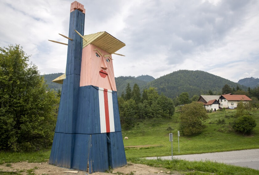 FILE - In this file photo dated Friday, Aug. 30, 2019, a wooden statue resembling Donald Trump near Kamnik, Slovenia. The wooden statue nearly eight-meter high (26 feet) of U.S. President Donald Trump that was constructed in 2019, has been destroyed by fire Thursday Jan. 9, 2020, in the homeland of his wife Melania Trump. (AP Photo/Darko Bandic, FILE)