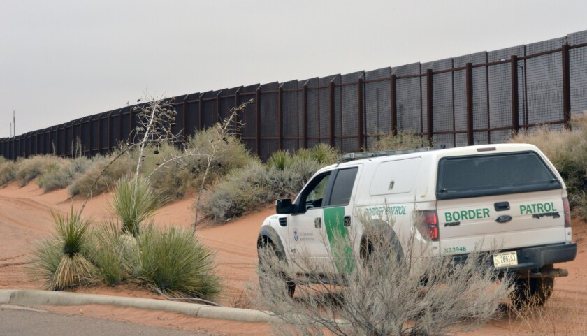 File - In this Jan. 5, 2016, file photo, a U.S. Border Patrol vehicle drives next to a U.S-Mexico bo
