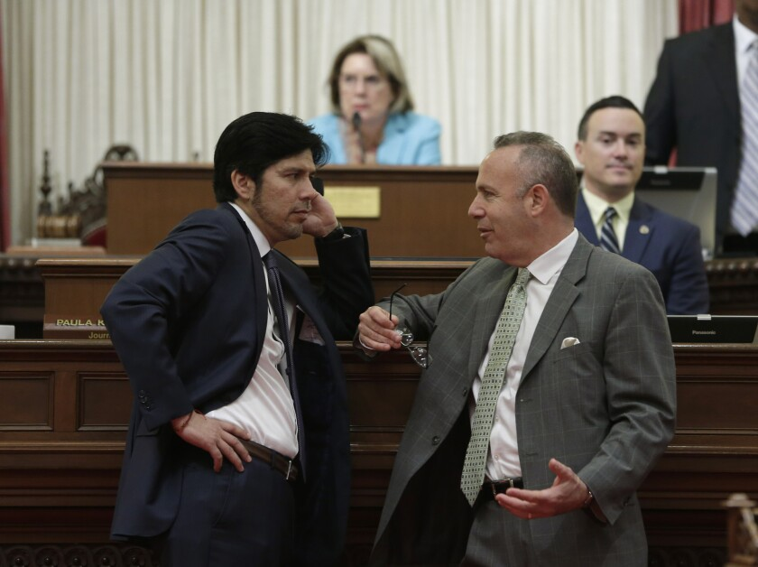 Sen. Kevin de León (D-Los Angeles), left, talks with Senate President Pro Tem Darrell Steinberg (D-Sacramento) during a recent Senate session. De León was elected Monday to take over as pro tem in October.